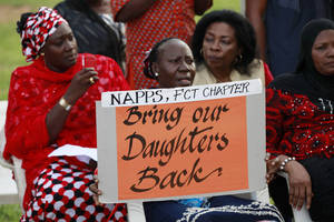 Photo - Women attend a sit down rally calling on the government to rescue the kidnapped school girls of the Chibok secondary school, in Abuja, Nigeria, Thursday, May 15, 2014. Islamic militants again attacked the remote Nigerian town from which nearly 300 schoolgirls were kidnapped, Nigeria's military said Wednesday, resulting in a firefight that killed 12 soldiers and led angry troops to fire into the air when their commanding officer came to pay respects to those killed at a barracks in Maiduguri, the state capital.  (AP Photo/Sunday Alamba)
