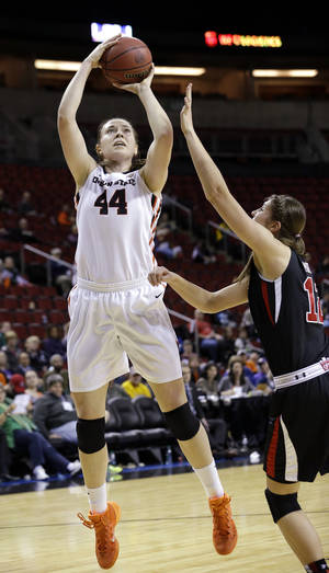 Photo - Oregon State's Ruth Hamblin (44) shoots over Utah's Emily Potter in the second half of an NCAA college basketball game in the Pac-12 women's tournament Friday, March 7, 2014, in Seattle. Oregon State won 50-35. (AP Photo/Elaine Thompson)
