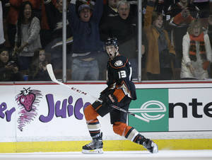 Photo - Anaheim Ducks' Nick Bonino celebrates his game-winning goal in overtime of an NHL hockey game against the Colorado Avalanche on Sunday, April 13, 2014, in Anaheim, Calif. The Ducks won 3-2 in overtime. (AP Photo/Jae C. Hong)