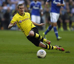 Photo - FILE - In this Oct. 26, 2014 file picture Dortmund's Sven Bender  plays the ball during the German first division Bundesliga soccer match between Schalke 04 and BvB Borussia Dortmund  in Gelsenkirchen, Germany. Borussia Dortmund midfielder Sven Bender has been ruled out for around 10 weeks with a groin injury. The Bundesliga club says the extent of the injury was revealed in an examination Sunday Feb. 23, 2014  by team doctor Markus Braun. Bender needs to avoid any sporting exertion for six weeks and Braun predicts a subsequent four-week recuperation period. Bender joins fellow midfielders Ilkay Gundogan and Jakub Blaszczykowski, as well as defender Neven Subotic, on the club's long-term injury list.  (AP Photo/Frank Augstein.File)