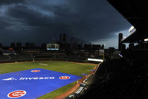 Photo -   Storm clouds move over Wrigley Field delaying the start of a baseball game between the Pittsburgh Pirates and Chicago Cubs, Monday, Sept. 17, 2012, in Chicago. (AP Photo/Jim Prisching)