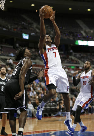 photo - Detroit Pistons guard Brandon Knight (7) drives against Brooklyn Nets forward Gerald Wallace (45) during the first half of an NBA basketball game in Auburn Hills, Wednesday, Feb. 6, 2013. (AP Photo/Paul Sancya)