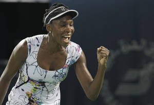 Photo - Venus Williams of the U.S. celebrates after she beats Alize Cornet of France during the final match of Dubai Duty Free Tennis Championships in Dubai, United Arab Emirates, Saturday, Feb. 22, 2014. (AP Photo/Kamran Jebreili)