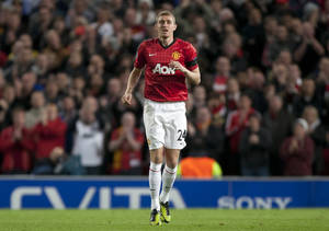 Photo -   Manchester United's Darren Fletcher takes to the pitch during his team's 1-0 win over Galatasaray in their Champions Graoup H soccer match at Old Trafford Stadium, Manchester, England, Wednesday, Sept. 19, 2012. (AP Photo/Jon Super)