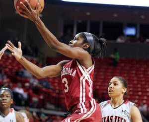 Photo - Oklahoma's Aaryn Ellenberg scores ahead of Texas Tech's Monique Smalls (23) during their NCAA college basketball game in Lubbock, Texas, Monday, March. 4, 2013. (AP Photo/Zach Long) ORG XMIT: TXLUB104