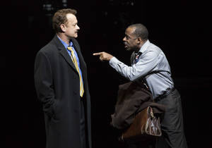 "Photo - This theater image released by Boneau/Bryan-Brown shows Tom Hanks as tabloid columnist Mike McAlary, left, and Courtney B. Vance as editor Hap Hairston during a performance of ""Lucky Guy,"" playing at the  Broadhurst Theatre in New York.  (AP Photo/Boneau/Bryan-Brown, Joan Marcus)"