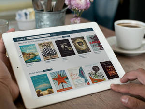 Photo - This product image provided by Scribd shows the Scribd e-book app. Scribd and Oyster let you read as many books as you want for a monthly price _ $9 for Scribd and $10 for Oyster. (AP Photo/Scribd)
