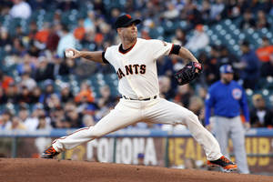 Photo - San Francisco Giants pitcher Tim Hudson throws to the Chicago Cubs during the first inning of a baseball game, Tuesday, May 27, 2014, in San Francisco. (AP Photo/George Nikitin)