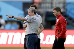 Photo - England's manager Roy Hodgson, left, and captain Steven Gerrard look at the quality of the pitch at the start of a training session of the England national soccer team at the Arena da Amazonia in Manaus, Brazil, Friday, June 13, 2014.  England play Italy in group D of the 2014 soccer World Cup at the stadium on Saturday.  (AP Photo/Matt Dunham)