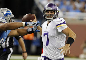Photo - Minnesota Vikings quarterback Christian Ponder (7) is pressured by Detroit Lions defensive tackle Ndamukong Suh during the third quarter of an NFL football game at Ford Field in Detroit, Sunday, Sept. 8, 2013. (AP Photo/Duane Burleson)