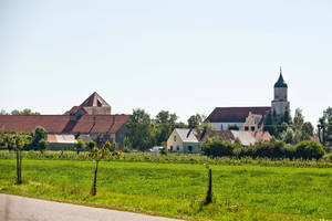 "Photo - This picture taken Thursday, Sept. 5, shows the village of Klosterzimmern near Deiningen, Germany, which is one of the homes of the ""Twelve Tribes"" sect. Police say they have raided the Christian religious sect in Bavaria and taken 40 children from them on allegations that they were being physically abused. Bavarian police said Friday, Sept. 6, 2013, that the children of the sect were taken into protective custody the day before as investigators look into allegations that they were being beaten and otherwise physically punished. Authorities say 28 of the children were found at one of the sect's locations in the town of Deinigen, and 12 others in Woernitz. (AP Photo/dpa, Daniel Karmann)"