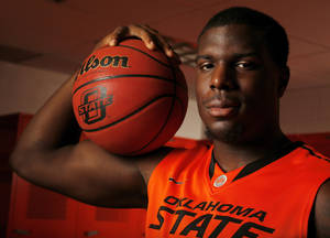 photo - COLLEGE BASKETBALL: OSU's Jean-Paul Olukemi (0) poses for a photo during basketball media day for Oklahoma State University at Gallagher-Iba Arena in Stillwater, Okla., Monday, Oct. 22, 2012. Photo by Nate Billings, The Oklahoman