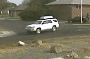 Photo -   This image from video provided by the FBI Friday, Oct. 12, 2012, shows a vehicle that authorities believe is involved in the abduction and sexual assault of a girl in Cody, Wyo., earlier in the week. The FBI said Thursday that based on witness statements and video footage from cameras in Cody, the SUV is believed to be a 2004 or 2005 white, 4-door Toyota SR-5 4-Runner, with a removable rooftop cargo box that's silver on top and black underneath. (AP Photo/FBI) Cody police have said a man lured an 11-year-old girl into his SUV Monday by claiming he needed help finding a missing puppy. The man threatened the girl with a pistol and sexually assaulted her before releasing her.