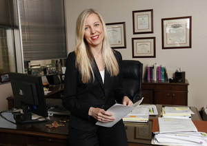 Photo - Amy Stipe, a shareholder at Gable Gotwals law firm, poses in her downtown office. Photo by Paul B. Southerland, The Oklahoman <strong>PAUL B. SOUTHERLAND</strong>