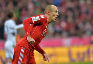 Photo - Bayern's  Arjen Robben of the Netherlands celebrates after scoring, during the German first division Bundesliga soccer match between  FC Bayern Munich and FC Schalke in Munich, Germany, on Saturday, March 1. 2014. (AP Photo/Kerstin Joensson)