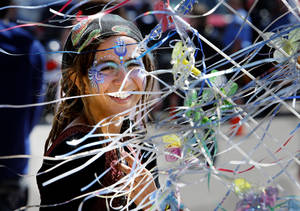 Photo - Above: Annie  Llamas, of Miami, Fla., stands by fairy wands Friday at the Medieval Fair in Norman.