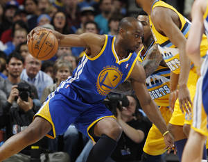 Photo - Golden State Warriors forward Carl Landry, left, works ball inside as Denver Nuggets forward Wilson Chandler covers in the third quarter of the Warriors' 131-117 victory in Game 2 of the teams' NBA first-round playoff series in Denver on Tuesday, April 23, 2013. (AP Photo/David Zalubowski)