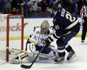 photo - St. Louis Blues' Patrik Berglund, right, of Sweden, scores on a penalty shot past Nashville Predators goalie Pekka Rinne, left, of Finland, during the second period of an NHL hockey game on Thursday, Jan. 24, 2013, in St. Louis. (AP Photo/Jeff Roberson)