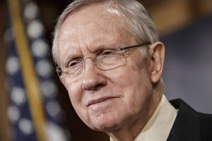 Photo - Senate Majority Leader Harry Reid, D-Nev., meets with reporters to urge passage of legislation to restore unemployment insurance benefits which expired Dec. 28, at the Capitol in Washington, Thursday, Jan. 9, 2014.  (AP Photo/J. Scott Applewhite)