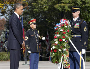 Photo -   President Barack Obama presents a wreath at the Tomb of the Unknowns at Arlington National Cemetery during a Veterans Day ceremony in Arlington, Va., Sunday, Nov. 11, 2012. (AP Photo/J. Scott Applewhite)