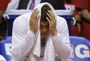 Photo - Los Angeles Clippers' Blake Griffin sits on the bench during the second half in Game 5 of a first-round NBA basketball playoff series against the Memphis Grizzlies in Los Angeles, Tuesday, April 30, 2013. The Grizzlies won 103-93. (AP Photo/Jae C. Hong)