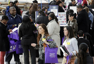 Photo - Job seekers attend a health care job fair March 14 in New York. A new Associated Press-GfK poll finds that only 1 in 4 Americans now expects his or her own financial situation to improve over the next year.  AP Photo
