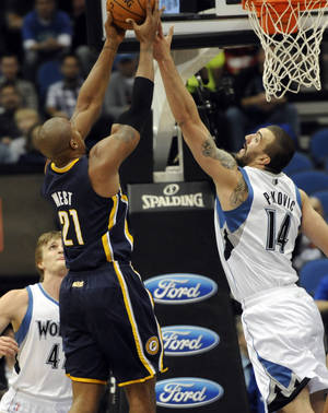 Photo -   Indiana Pacers' David West, left, beats Minnesota Timberwolves' Nikola Pekovic of Montenegro to the rebound in the first half of an NBA basketball game, Friday, Nov. 9, 2012, in Minneapolis. (AP Photo/Jim Mone)