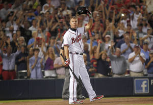 Photo -   Atlanta Braves' Chipper Jones tips his helmet to the crowd at his last at-bat during the ninth inning of the National League wild card playoff baseball game against the St. Louis Cardinals, Friday, Oct. 5, 2012, in Atlanta. The Cardinals won baseball's first wild-card playoff, taking advantage of a disputed infield fly call that led to a protest and fans littering the field with debris to defeat the Braves 6-3. (AP Photo/John Bazemore)