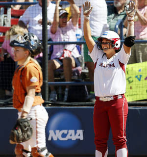 Photo - OU's Lauren Chamberlain (44) reacts after scoring the final run for Oklahoma near Texas catcher Mandy Ogle (5) during an NCAA softball game in the Women's College World Series between Oklahoma and Texas at ASA Hall of Fame Stadium in Oklahoma City, Saturday, June 1, 2013. Oklahoma won 10-2 in five innings. Photo by Nate Billings, The Oklahoman