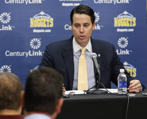 Photo - Josh Kroenke, president of the NBA Denver Nuggets, talks about the firing of coach George Karl and the future of the Nuggets at a news conference at the Pepsi Center in Denver on Friday, June 7, 2013. (AP Photo/Ed Andrieski)