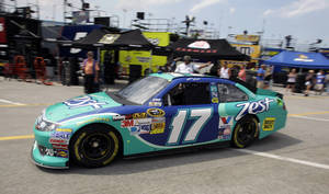 Photo -   Matt Kenseth (17) leaves the garages during practice for the NASCAR Sprint Cup Series Coke Zero 400 auto race at Daytona International Speedway, Thursday, July 5, 2012, in Daytona Beach, Fla. (AP Photo/John Raoux)