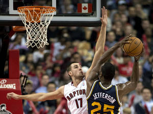 photo -   Toronto Raptors center Jonas Valanciunas (17) defends against Utah Jazz center Al Jefferson (25) during the first half of an NBA basketball game in Toronto on Monday, Nov. 12, 2012. (AP Photo/The Canadian Press, Frank Gunn)