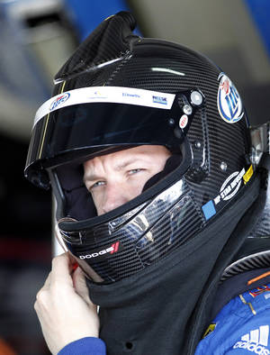 photo -   Driver Brad Keselowski adjusts his helmet the garage before practice for Sunday's NASCAR Sprint Cup Series auto race at Homestead-Miami Speedway Saturday, Nov. 17, 2012 in Homestead, Fla. (AP Photo/Terry Renna)