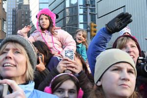 photo -   People watch the 86th Annual Macy's Thanksgiving Day Parade, Thursday Nov. 22, 2012, in New York. The annual Macy's Thanksgiving Day Parade put a festive mood in the air in a city still coping with the aftermath of Superstorm Sandy. (AP Photo/Tina Fineberg)