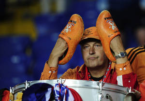 Photo -   A Dutch fan sits dejected after the Euro 2012 soccer championship Group B match between Portugal and the Netherlands in Kharkiv, Ukraine, Sunday, June 17, 2012. (AP Photo/Manu Fernandez)