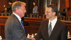 Photo - U.S. Sen. Jim Inhofe greets U.S. Magistrate Judge Robert E. Bacharach at a recent hearing on Capitol Hill. <strong> - File Photo</strong>