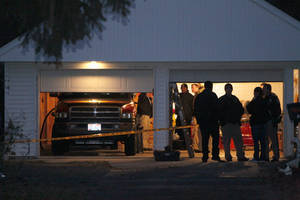 Photo -   Authorities respond to a report of carbon monoxide poisoning on Harvest Lane in Toledo, Ohio, on Monday, Nov. 12, 2012. The bodies of three children and two adults were found inside the garage Monday, and authorities said they believe the deaths — apparently from carbon monoxide poisoning — weren't accidental. (AP Photo/The Blade, Amy E. Voigt) MANDATORY CREDIT; MAGS OUT; TV OUT; SENTINEL-TRIBUNE OUT; MONROE EVENING NEWS OUT; TOLEDO FREE PRESS OUT
