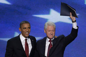 photo -   Former President Bill Clinton waves to the delegates as he stands with President Barack Obama after Clinton addressed the Democratic National Convention in Charlotte, N.C., on Wednesday, Sept. 5, 2012. (AP Photo/J. Scott Applewhite)