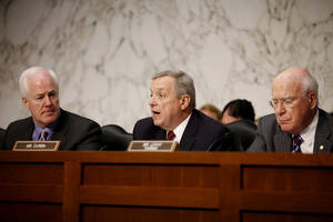 "photo - FILE - In this Tuesday, June 28, 2011 file photo, Sen. Richard Durbin, D-Ill., center, flanked by Sen. John Cornyn, R-Texas, left, and Sen. Patrick Leahy, D-Vt., speaks during a meeting on Capitol Hill in Washington. The Senate holds its second hearing Tuesday, Feb. 12, 2013, on gun curbs since the December 2012 shooting deaths of 20 first-graders in Newtown, Conn. This time, a Senate Judiciary subcommittee is examining the constitutionality and effectiveness of federal firearms limits. ""We need to keep guns out of the hands of criminals and those who are mentally unstable,"" Durbin, D-Ill., said in a brief interview Monday, Feb. 11, 2013. ""I hope everyone will acknowledge what within our Constitution is not only an individual right to bear arms, but the collective right of Americans to be safe."" (AP Photo/Charles Dharapak, File)"