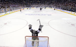 Photo -   Los Angeles Kings goalie Jonathan Quick celebrates after the Kings scored an empty-net goal against the St. Louis Blues during the third period in Game 4 of an NHL hockey Stanley Cup second-round playoff series, Sunday, May 6, 2012, in Los Angeles. The Kings won 3-1 to win the series 4-0. (AP Photo/Mark J. Terrill)