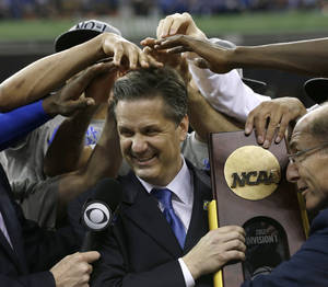 Photo -   Kentucky head coach John Calipari, center, celebrates with his team after the NCAA Final Four tournament college basketball championship game against Kansas Monday, April 2, 2012, in New Orleans. Kentucky won 67-59. (AP Photo/David J. Phillip)