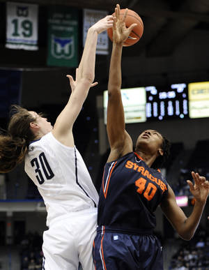 photo - Connecticut's Breanna Stewart, left, and Syracuse's Kayla Alexander fight for a rebound in the second half of an NCAA college basketball game in the semifinals of the Big East Conference women's tournament in Hartford, Conn., Monday, March 11, 2013. (AP Photo/Jessica Hill)