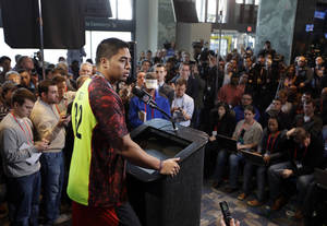 Photo - Notre Dame linebacker Manti Te'o answers a question during a news conference at the NFL football scouting combine in Indianapolis, Saturday, Feb. 23, 2013. (AP Photo/Michael Conroy)