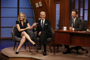 "Photo - In this photo provided by NBC, from left, actress Amy Poehler and Vice President Joe Biden appear with host Seth Meyers on the premiere of ""Late Night with Seth Meyers"" on Monday, Feb. 24, 2014, in New York. (AP Photo/NBC, Peter Kramer)"