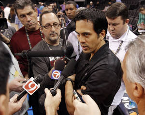 photo - Miami Heat head coach Erik Spoelstra talks to the media after practice for the first game of the NBA basketball finals at the Chesapeake Arena on Tuesday, June 12, 2012 in Oklahoma City, Okla.  Photo by Steve Sisney, The Oklahoman