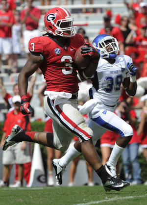 Photo -   Georgia running back Todd Gurley (3) outruns Buffalo defensive back Marqus Baker (39) for a touchdown during the second half of an NCAA college football game, in Athens, Ga., Saturday, Sept. 1, 2012. (AP Photo/John Amis)