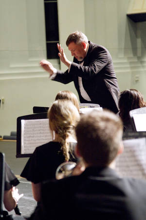 Photo - Clint Brown directs the Yukon High School band during the OSSAA band competition on Wednesday. Photo by Steven N. Maupin, for The Oklahoman <strong>Steven N. Maupin - FOR THE OKLAHOMAN</strong>