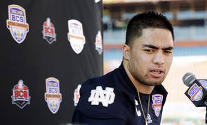 Photo - FILE - In this Jan. 5, 2013, file photo, Notre Dame linebacker Manti Te'o answers a question during media day for the BCS national championship NCAA college football game in Miami. The wrenching story of Te'o's girlfriend dying of leukemia _ a loss he said inspired him to play his best all the way to the BCS championship _ was dismissed by the school Wednesday, Jan. 16, as a hoax perpetrated against the linebacker. (AP Photo/David J. Phillip, File) ORG XMIT: NY166