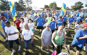 Photo - Supporters took part in a NAMI Oklahoma fundraising walk in May. The organization has several events scheduled for national Mental Illness Awareness Week, Oct. 7-13. PHOTO BY PAUL HELLSTERN, THE OKLAHOMAN