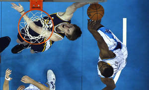 Photo -   Utah Jazz guard Gordon Hayward (20) battles under the basket with New Orleans Hornets forward Darius Miller in the first half of an NBA basketball game in New Orleans, Wednesday, Nov. 28, 2012. (AP Photo/Gerald Herbert)